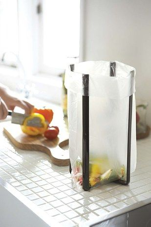 """A handy, dandy """"tower"""" you can use as a plastic bag holder *or* a bottle dryer."""
