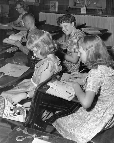 Not paying attention in class. 1961.