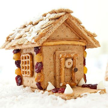 Give your traditional gingerbread house an extreme makeover by swapping the candy for more wholesome ingredients. To make the house, trim graham cracker walls and a roof with a serrated knife, then join them with peanut butter. (To pipe it, spoon several tablespoons of peanut butter into a plastic bag and snip off a corner.) Decorate the house with healthy snacks, such as cereal, nuts, and dried fruit, attached with more peanut butter. Can't use nut products? Substitute cream cheese for a…