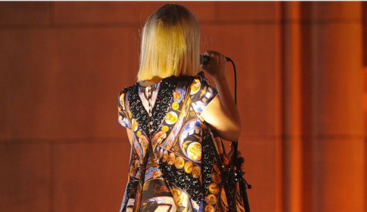Australian singer/songwriter Sia. Sia often performs with her back to the camera due to her aversion of fame.