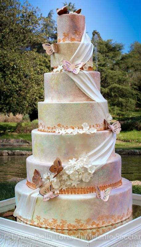 Love the idea of a cake with a white background and then a cascading drape line in this one but featuring double happiness.