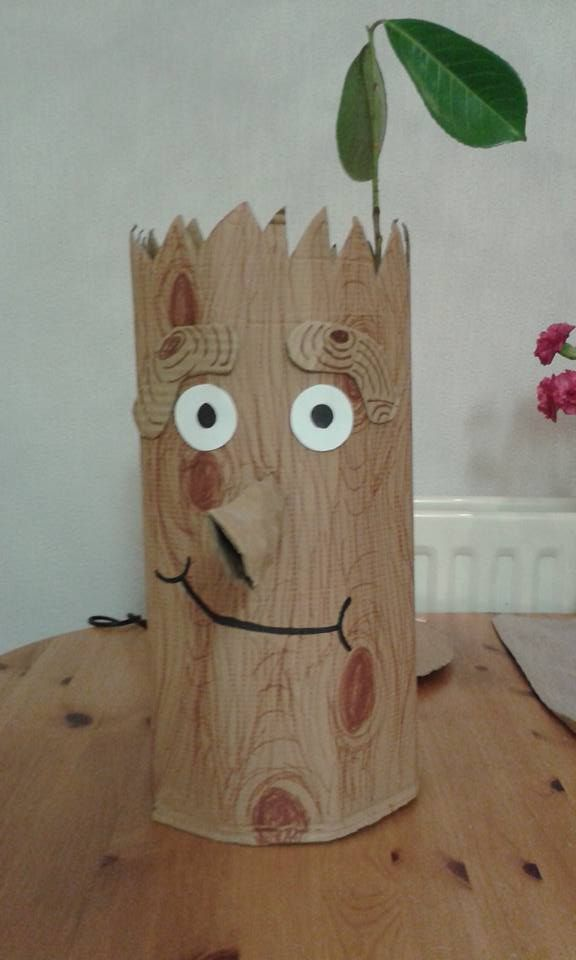 Stick Man. Made from a cardboard box manipulated into a cylinder then cut at top to form 'hair'  Eyebrows and nose made from left over pieces of same box and eyes are white card. Wood effect and mouth drawn on with sharpie. Leaves found outside and added for effect. To be worn on head or holes could be cut for eyes to wear over head.