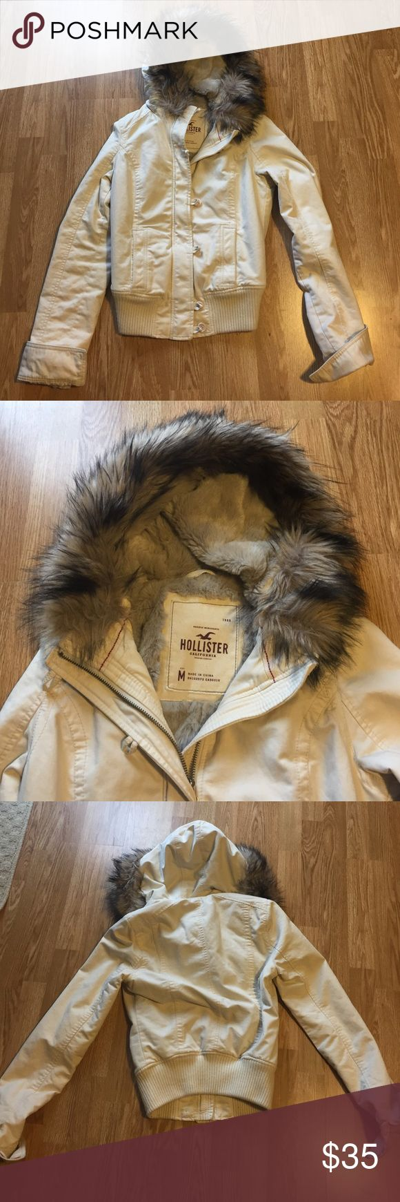 Hollister bomber jacket Women's Hollister bomber jacket, light cream color with grey fur in hood and chest of jacket. Very light wear on end of sleeves but overall in great condition! Hollister Jackets & Coats