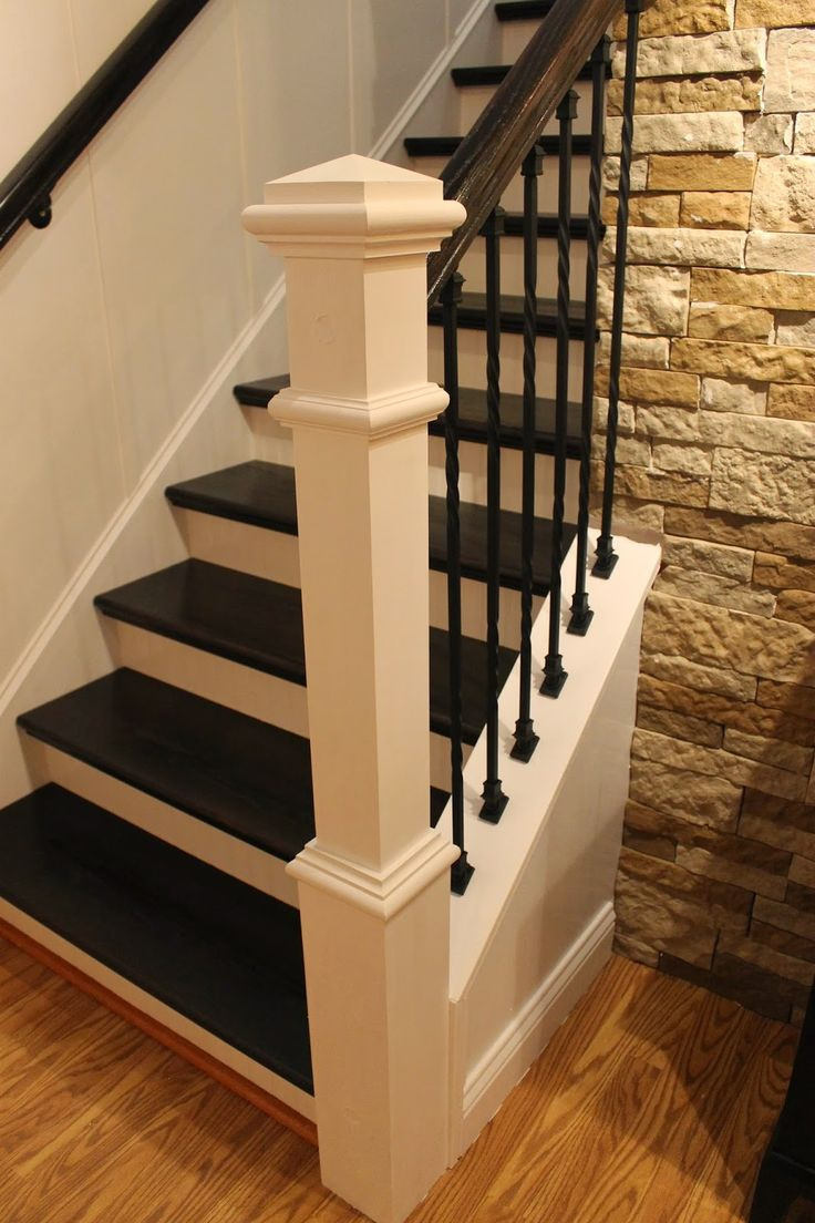 carpeted staircase into one with wooden treads and iron balusters more