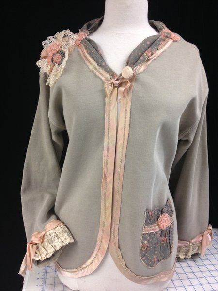 Up-cycle sewing at it's best...a sweatshirt and pair of elastic-waist printed rayon pants create this lovely jacket when teamed with antique laces and hand-dyed silk trim. Add it to YOUR wardrobe today.