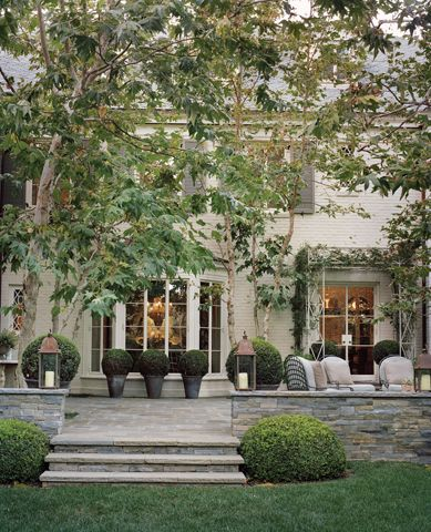 elegant terrace, pale stone, lanterns and topiary - ferguson shamamian architects