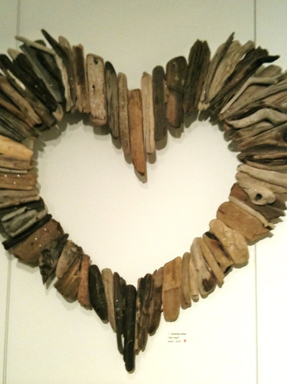 Driftwood art...maybe a circle, mirror frame, or something else instead of a heart.  For the island cottage.