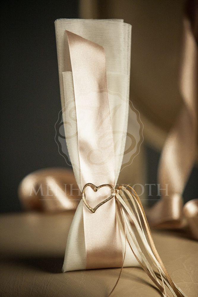 Μπομπονιέρα γάμου με μεταλλική καρδιά. Elegant wedding favour - bomboniere