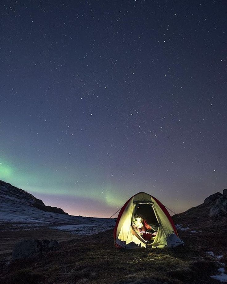 Camping beneath the northern lights.