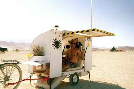 Built for Burning Man, this camper weighs 100 pounds and is packed with a solar oven and a solar water heating system, and has a wind turbine and solar lights on the exterior.