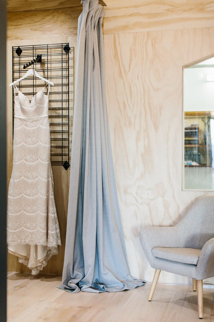 A couture gown, hanging in pride of place in the renovated Calèche showroom, Norwood, South Australia