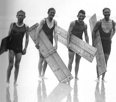Young surfers in Cornwall, UK, with boards supplied by the local coffin maker. Fun times, 1920s!