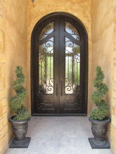 Front door.  Model Home - mediterranean - exterior - austin - River Hills Custom Homes