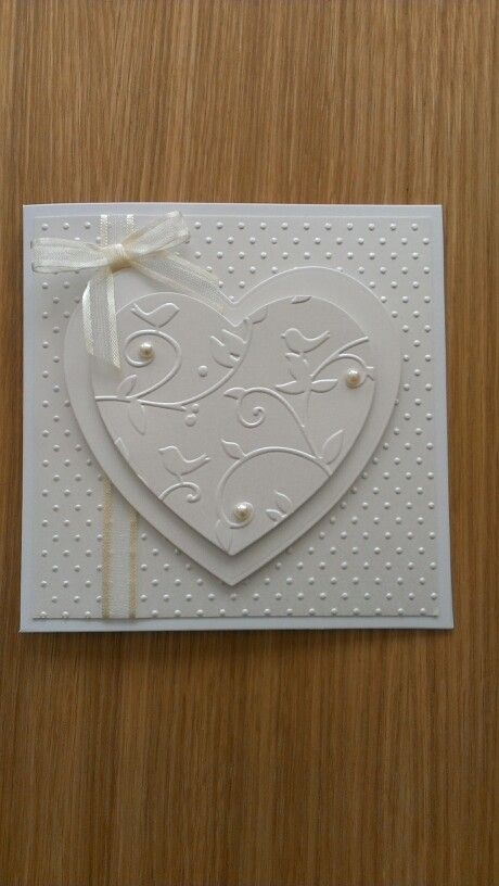 handmade Anniversary card ... white on white ... clean and simple layout ... dots texture embossing folder used for background ... double layered heart ... like it!