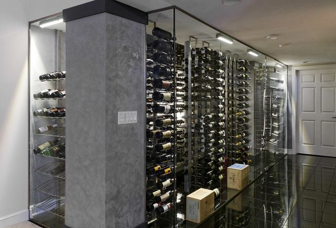 Nice modern wine cellar. Love the glass and metal.