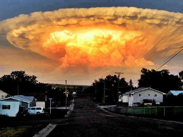 Thunderhead Cloud or a Cumulonimbus cloud. The color is caused by the rays of the sun shining into the cloud.  Photographer: Karen Titchener