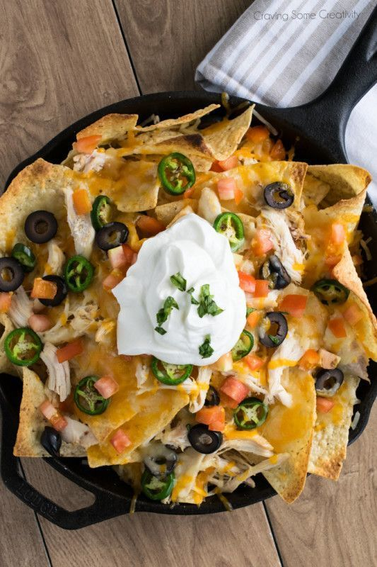 Shredded Chicken Nachos - Shredded Chicken and Cheese, Olives, Pickled Jalapenos and alll the trimmings for a supreme appetizer or super bowl party food.