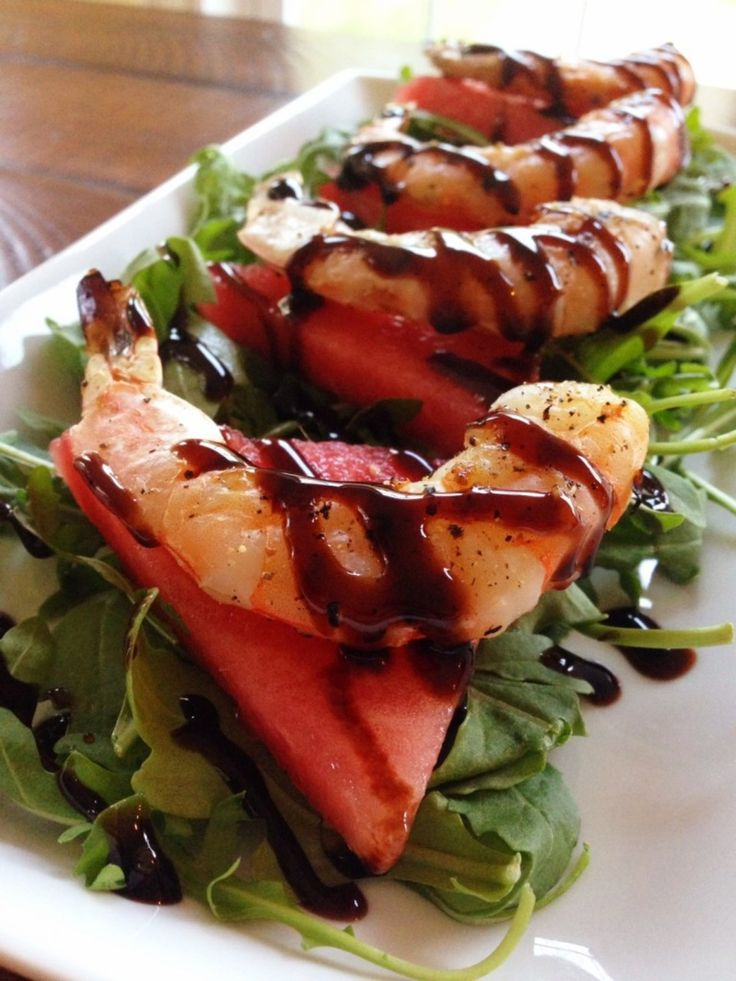 Watermelon & Arugula Salad with Grilled Shrimp, Drizzled with a Balsamic Glaze  http://thefitfoodiemama.com/watermelon-arugula-salad-with-grilled-shrimp-drizzled-with-a-balsamic-glaze/ #SummerSalad