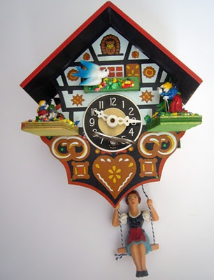 A cute vintage Swiss clock with a girl on a swing!