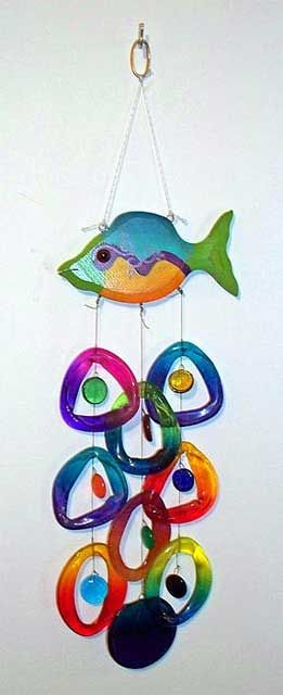 The fish is painted wood.  The rings are slices of wine bottles.  It could be made with pony beads.