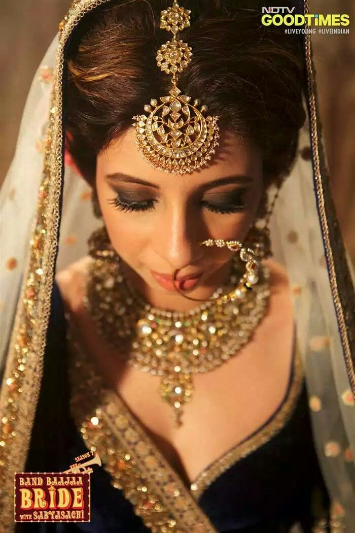 Boho bride shreya's magical transformation into a sabyasachi bride. Makeup by ace makeup artist Abhijit Chandak, jwellery by Krishnadas & co for sabyasachi and beautiful blue lehenga by Sabyasachi