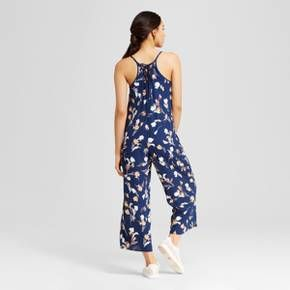 When you want to get noticed, the Women's Wide-Leg Jumpsuit by Xhilaration™ (Juniors') will be your first choice. The cool cut with soft movement gives the women's sleeveless printed romper seasonal appeal.<br><br>Used to Women's sizes? Size up in Junior's or check the size chart to determine best fit.