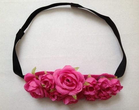 Flower crown decorated with pink roses.