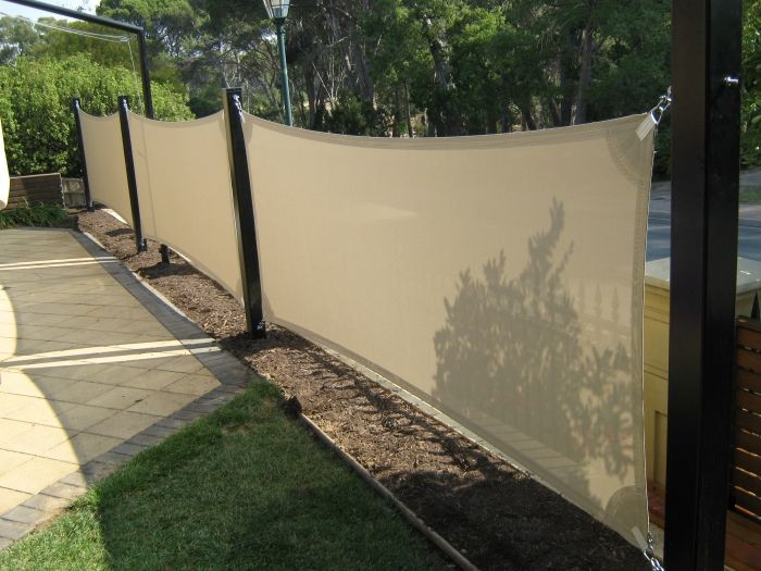 vertical shade sails a option for privacy fence