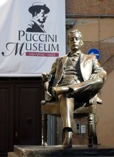 Puccini is memorialized by a bronze statue which stands outside his birthplace.