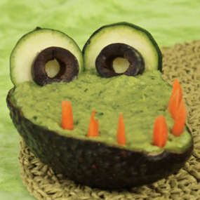 Crocamole! Fun way to serve guacamole in the avocado shell.maybe at a Jake & the Neverland pirates party.