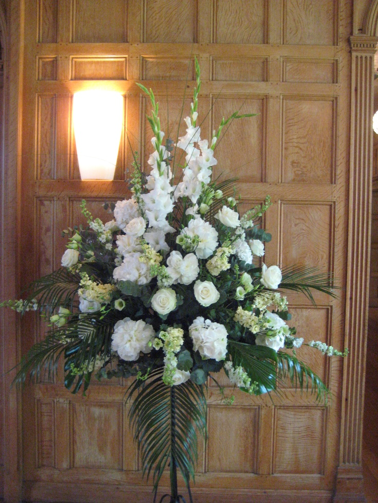 A Large Front Facing Pedestal Arrangement With Tall White