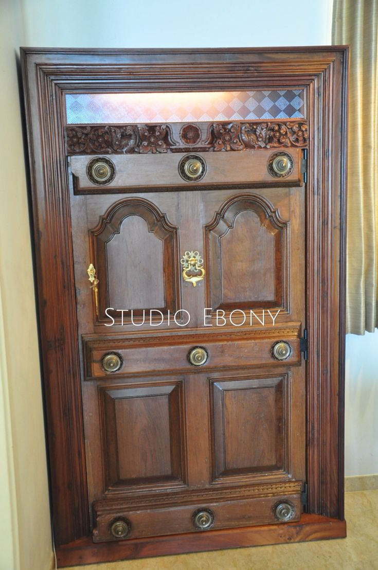Wine Cabinet, An old period door converted to a wine cabinet by Studio Ebony. Chennai.India.