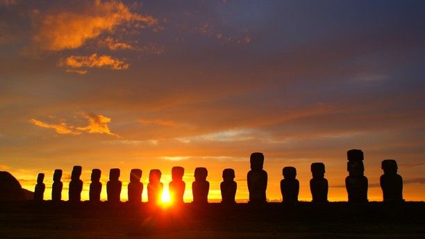 Easter Island, Easter Island, Chile — by AdventureJ. Watching a stunning sunrise behind the Tongariki Moai on Easter Island. Definitely worth the early morning wake up call!