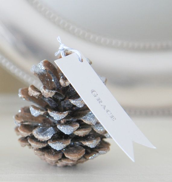 glittered pinecone seating cards escort cards with custom sash collection of gold silver or white