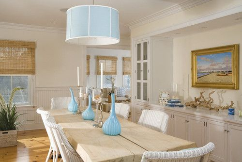 I adore the combination of colours here. Light blue sky, beige sand, and white spray, as Samantha Schoech describes it. LOVE that pendant lamp.   Dining room by Workshop/apd