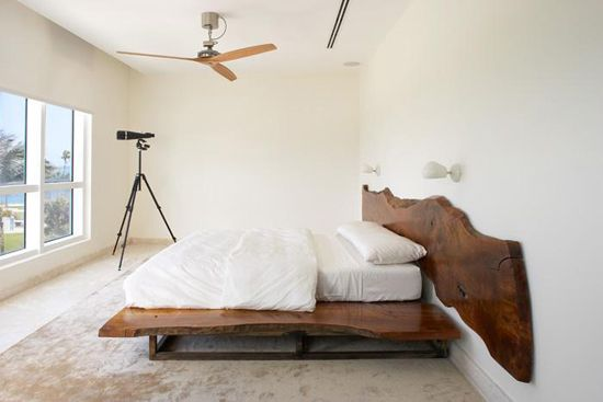 Wood slab headboard | Design by Magdalena Keck, photo by Jeff Cate