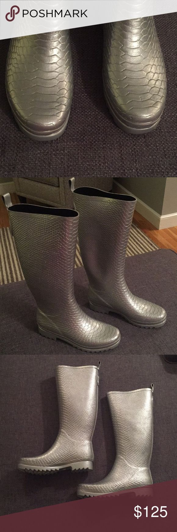 "✨ Stuart Weitzman Embossed Silver Wellies Stuart Weitzman Crocodile Embossed Silver Rain Boots or Wellies. These adorable rubber boots are in excellent condition, worn once, and super comfortable. The inside of the upper shaft measures 14.25"", and height is 15.5"". Stuart Weitzman Shoes Winter & Rain Boots"