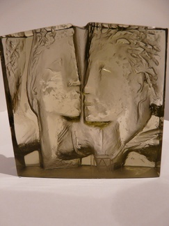 JAN CERNÝ ART OBJECT. A Professor Jan Cerný (1907-1978), frosted (semi transparent), mould-melted smoke glass sculpture for MAJAK, Jablonec nad Nisou, Czechoslovakia, 3rd quarter 20th century. Formed as a flatback sculpture depicting a couple in relief. With etched signature Prof Jan Cerny and Art Czechoslovakia adhered label.