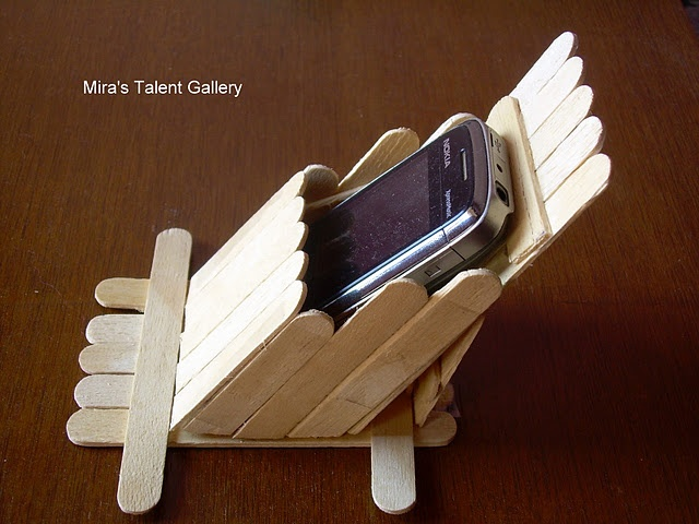 A popsicle mobile holder - a cozy place for your mobile to recline when at rest :-)   Created by Mira!  DIY project tutorial @ http://my-hobby-lounge.blogspot.in/2012/01/stand-to-keep-mobile-popsicle-ice-stick.html