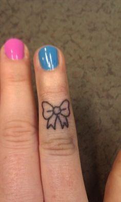 Small bow tattoo