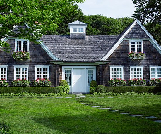 Bright white is often overlooked when picking a door color! More of our favorite cottage style homes: http://www.bhg.com/home-improvement/exteriors/curb-appeal/cottage-style-home-ideas/?socsrc=bhgpin071214softenahomesedges&page=2