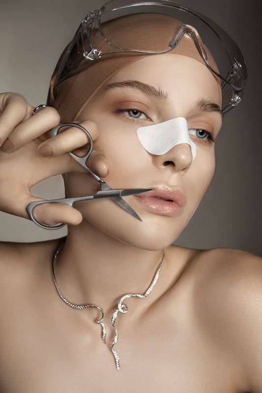 """The Masha Voronina Tush Winter spread for 2010 gives readers a slightly deeper look into the ""beauty"" of cosmetics surgery. Through this editorial, it is clear that going under the knife isn't all that easy. Complexities, bandages and cut-out lines upon the skin are more scary than fashionable. With her fresh, clean face there is no need for this model to get any work done, but she sure beautifies cosmetic surgery in the Masha Voronina Tush Winter spread."" - Trendhunter"