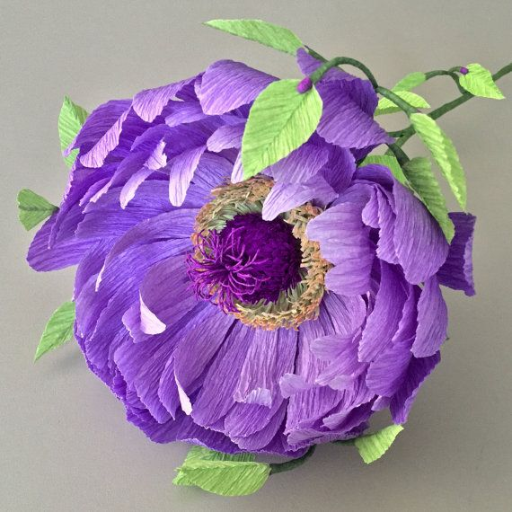 Now introducing crepe paper flowers from the imagination! This beautiful, one-of-a-kind fantasy flower comes in elegant shades of purple. Every detail has been carefully planned, designed, and constructed for a whimsical bloom that looks like it was picked straight from a fairy garden. This show-stopper can stand alone in your favorite vase or be paired with coordinating Nectar Hollow blooms for a fantastical arrangement that doesnt require water and will never wilt or die. Dimensions: This…