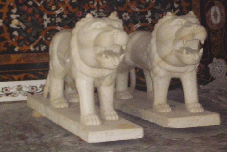 its hand made white marble lion two pair used best of carving of of face like real lion.