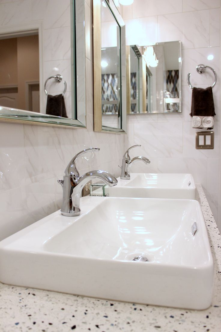 This Guest Bath Features A Stunning Shower Accent Wall, Floor To Ceiling  Tile Walls, · Glass CountertopsCeiling ...