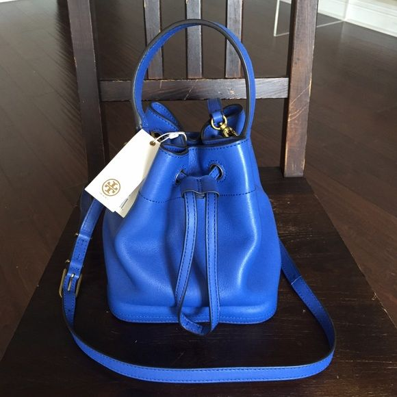 Tory Burch Mini Bucket Bag (Neptune color) A gorgeous gorgeous bag, sold out online! Buttery soft leather, vibrant blue color & convenient size! Adjustable strap, messenger length. On-trend, unique bucket style  (no trades please!) Tory Burch Bags