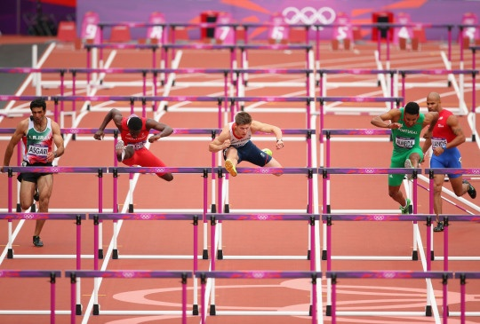 Wayne Davis of Trinidad and Tobago, Lawrence Clarke of Great Britain and Joao Carlos Almeida of Portugal compete in the Men's 110m Hurdles Round 1 Heats on Day 11 of the London 2012 Olympic Games at Olympic Stadium on Aug. 7, 2012.    Credit: Cameron Spencer/Getty Images