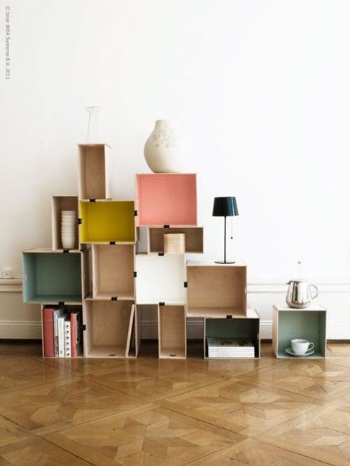 stacked storage. i love the empty colored boxes and the random storage