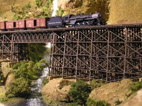 Northern Pacific N-Scale Railroad - Robert Ray... the trestle and bridge were a labor of love, each piece individually cut and fit to shape and size. The warmth of the colors used by Robert in the layout, the reddish browns, and beiges in particular, combine with the splashes of greenery, to create a sense of welcoming power.