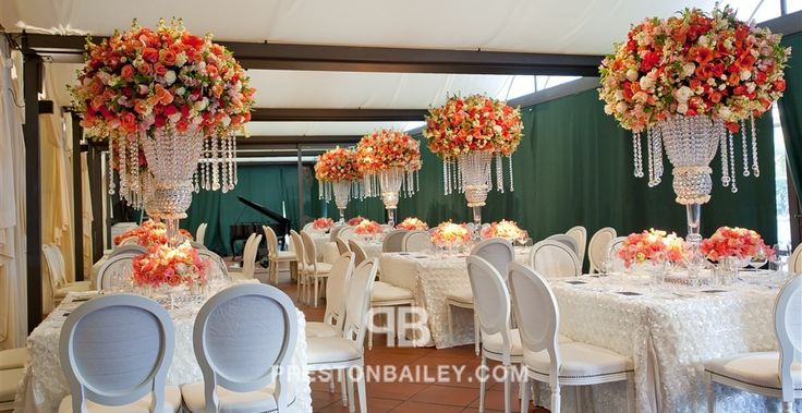 Tall centerpieces with hanging crystal - crystals, restaurant, roses, round tables, table setting, tall centerpiece, vase, wedding, color|coral, color|cream, color|white